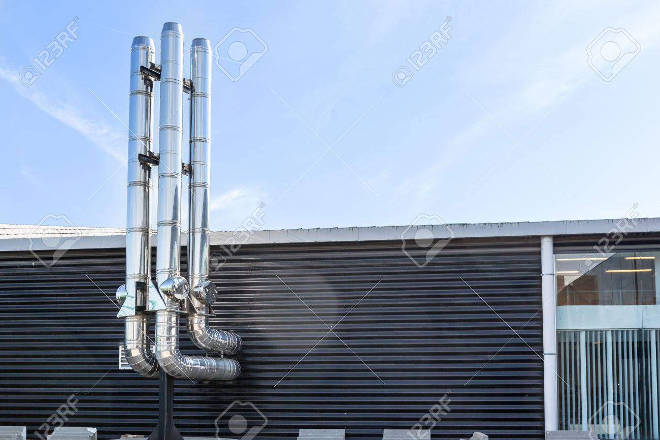 inox Chimney tube next the flat roof in the city - 74474754