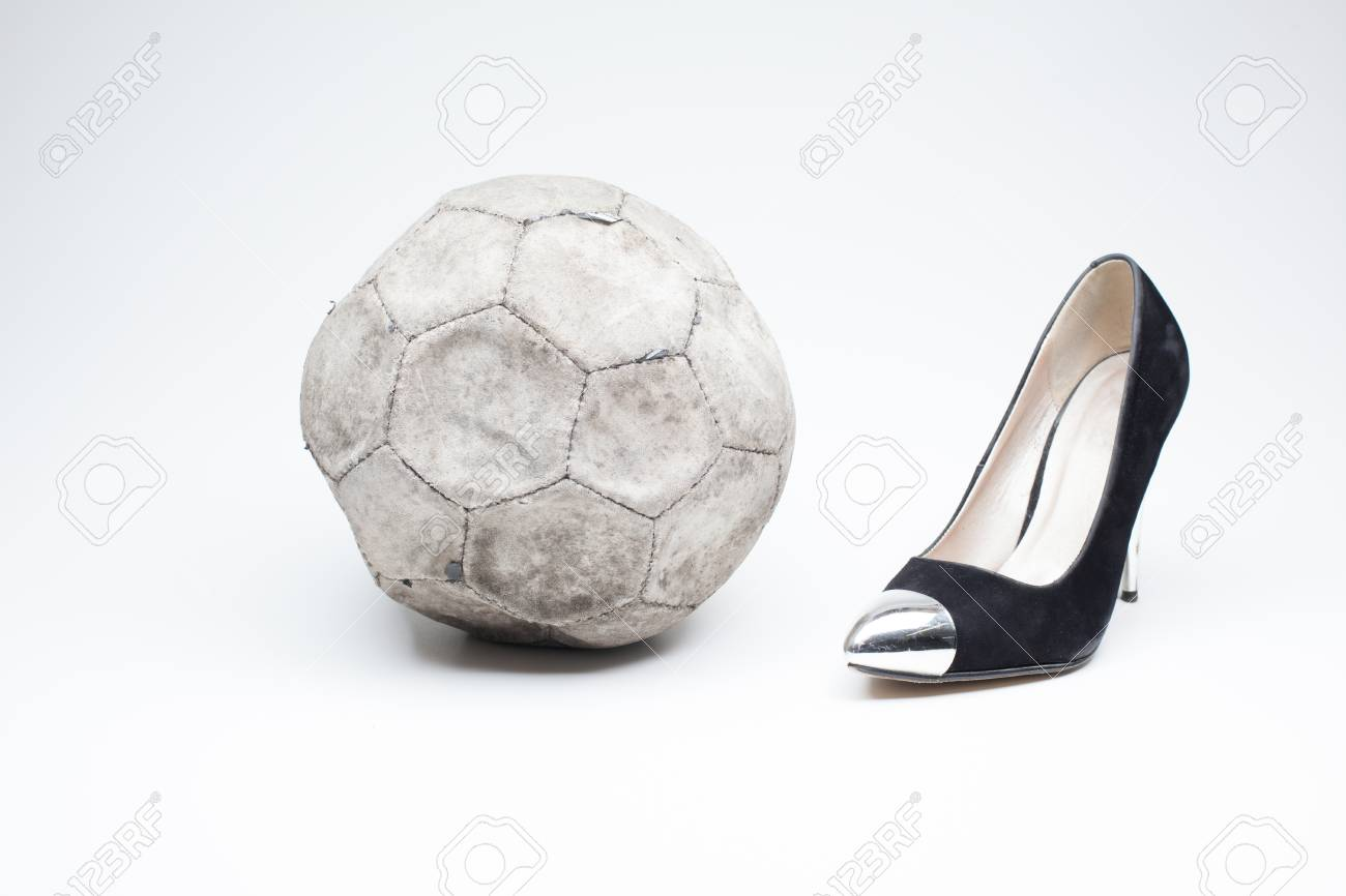 891a18dcc87 black old ladies shoe on high heels on a white background whit an leather  football Stock