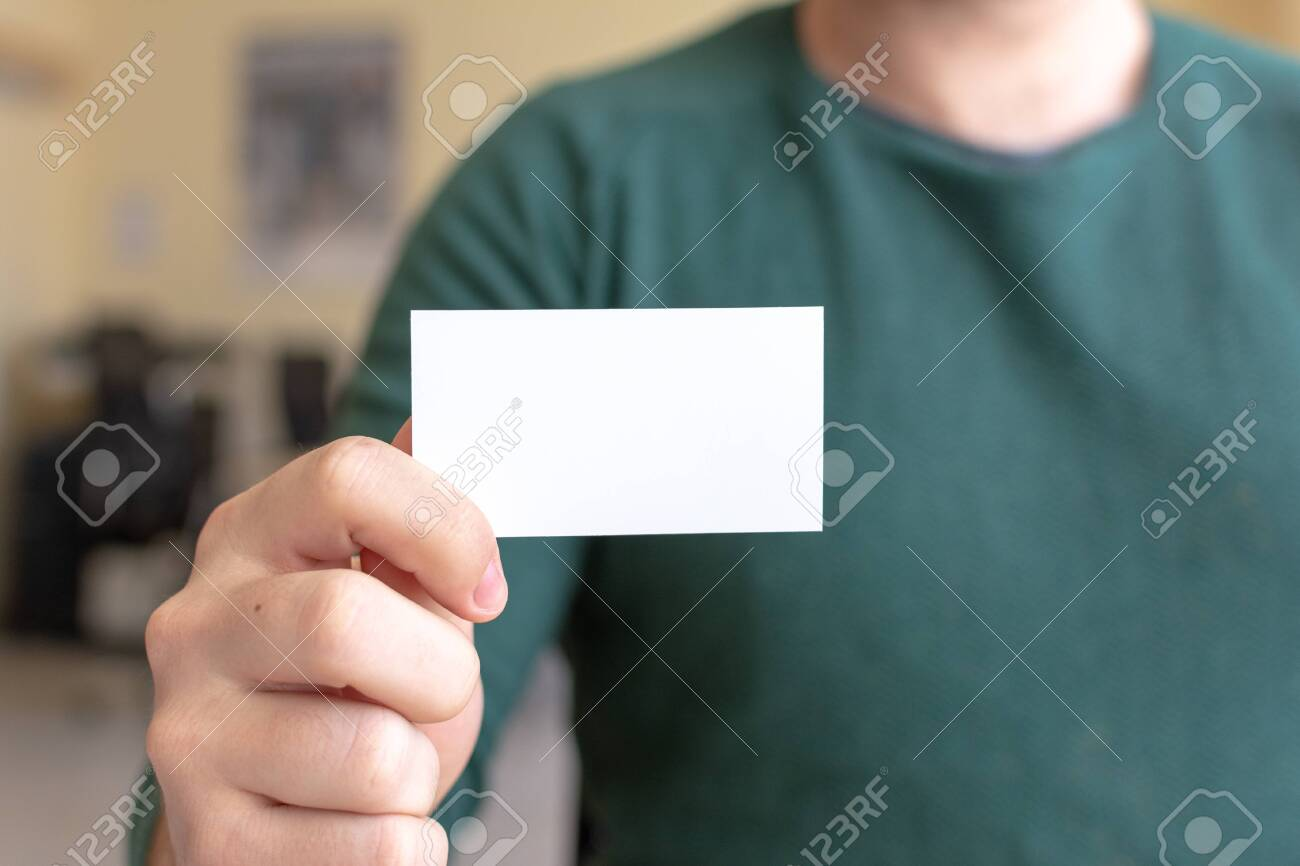 Business Card Mock-Up - Man Holding a Blank Card for Clients. Business Card Template. - 122849438