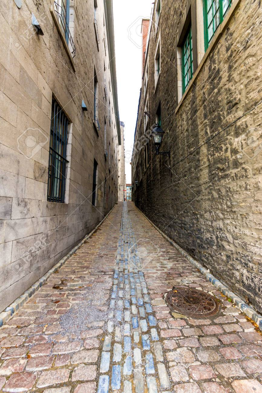 Small Narrow Street In Old Montreal In Vertical Picture At Wide Angle Stock Photo 28864604