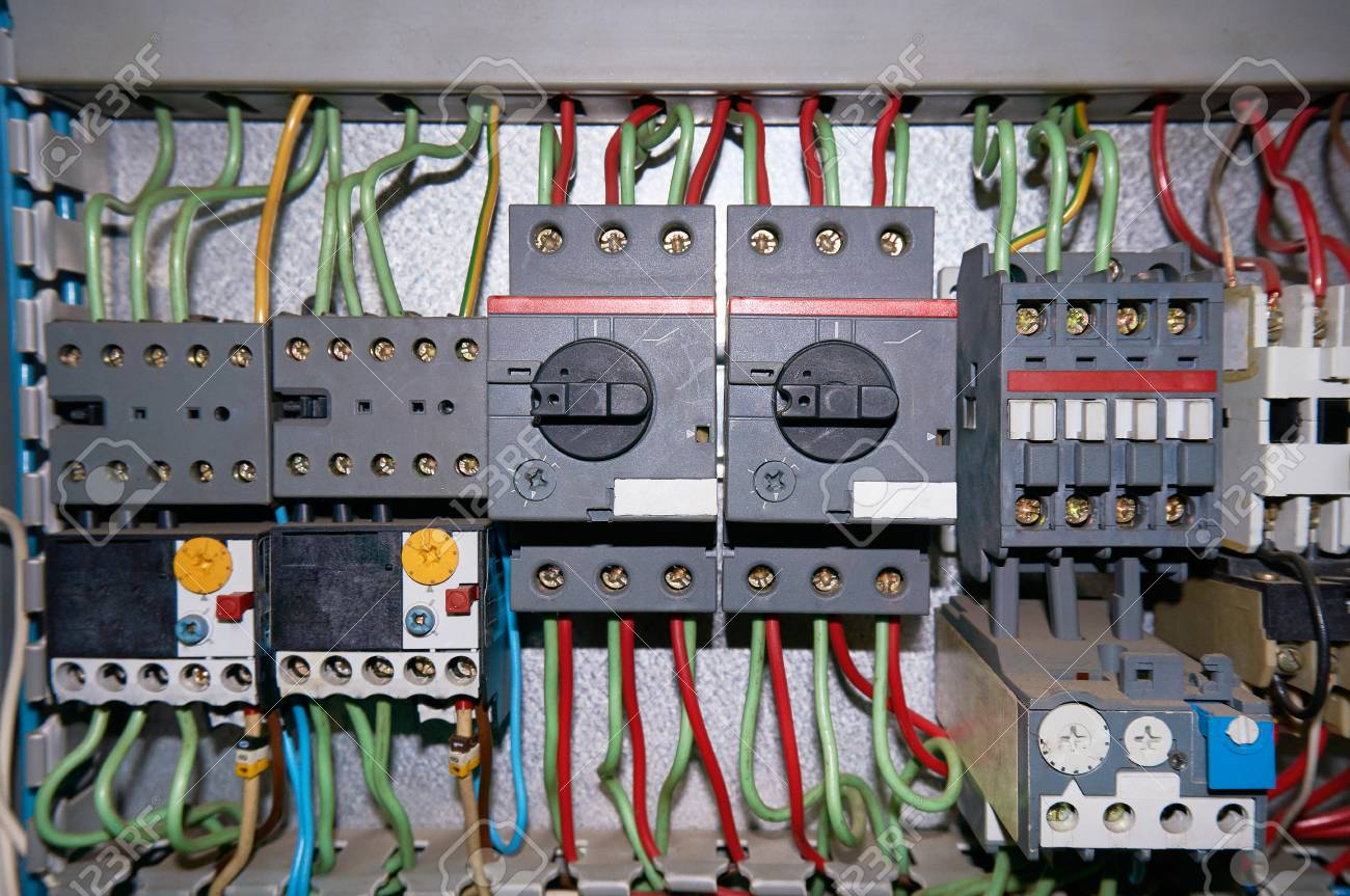 Group of high-voltage electric relays with connected wires. on