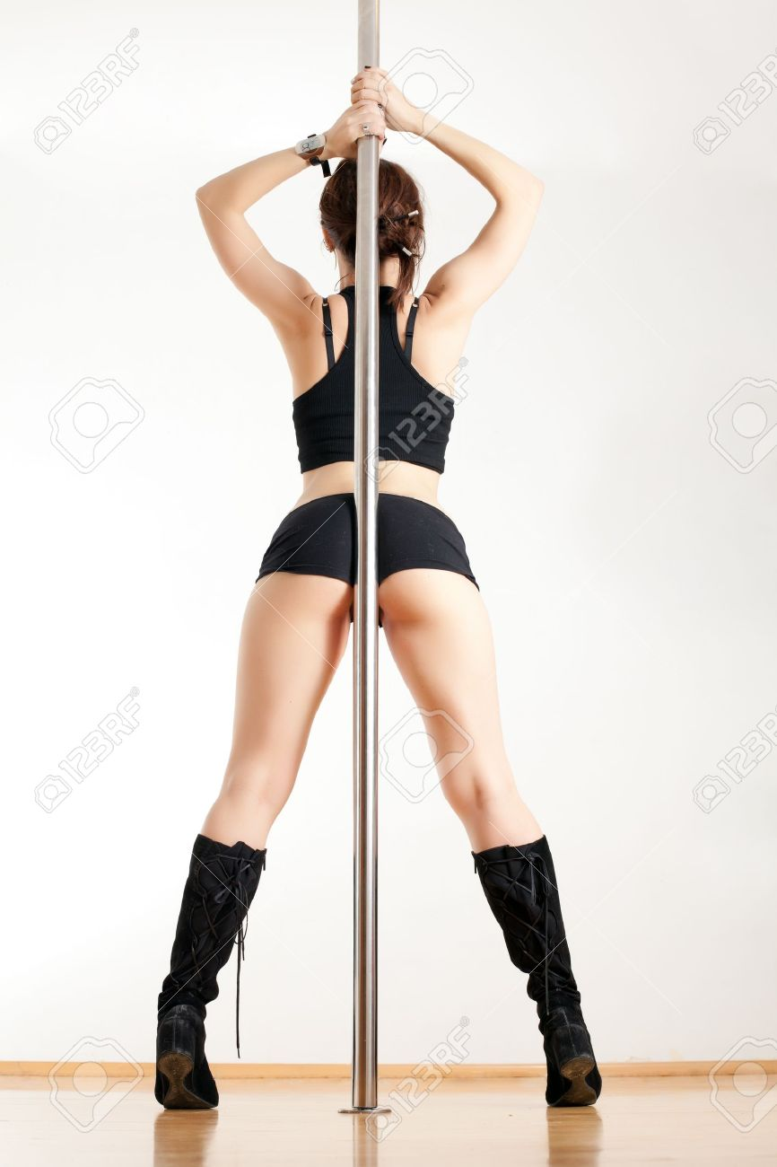 Back of the young woman near a pole Stock Photo - 17544525
