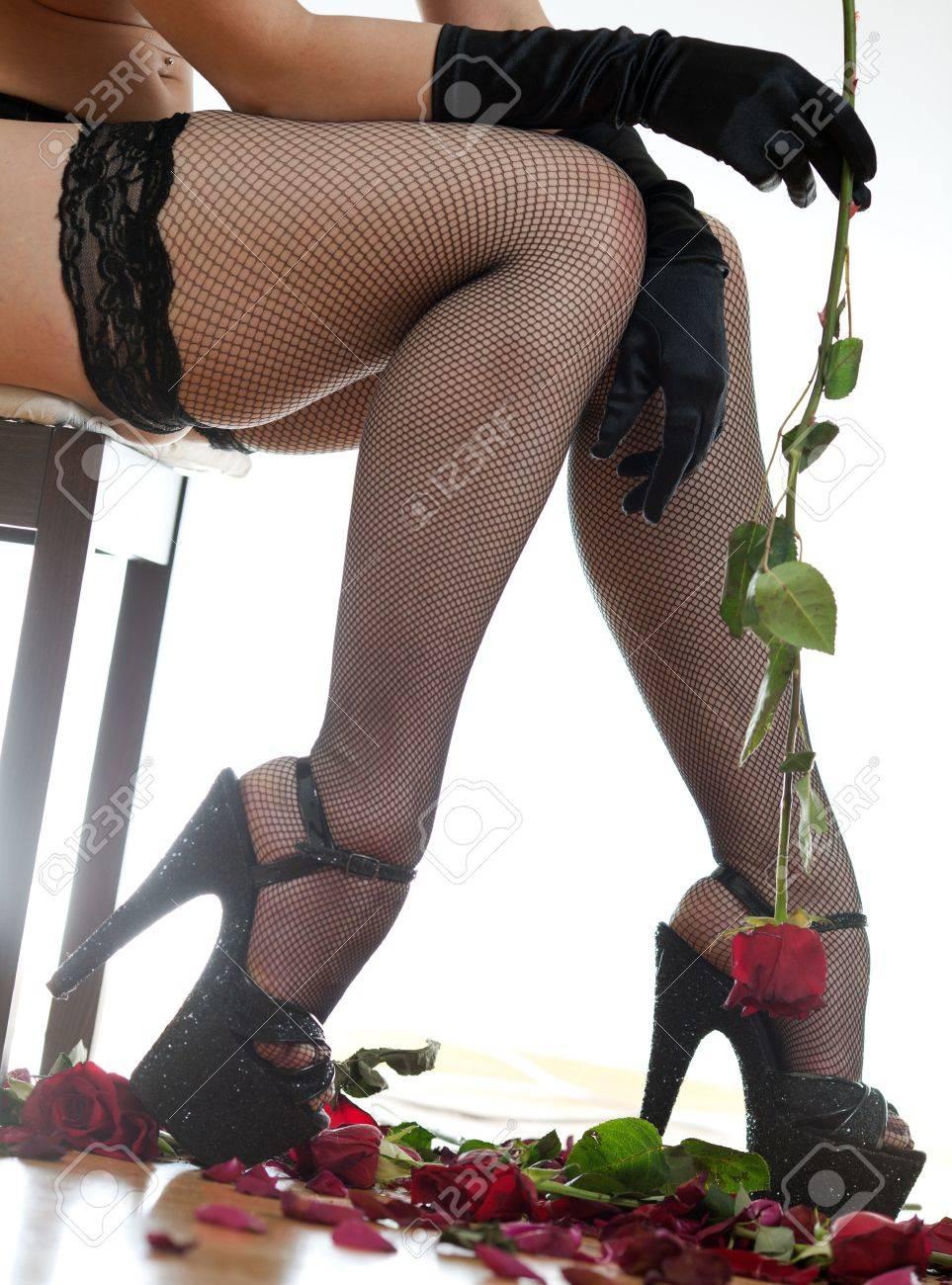 women s feet and rose Stock Photo - 18442459