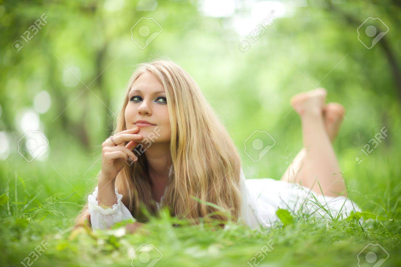 woman with long hair lying on the grass and dreaming Stock Photo - 20145462