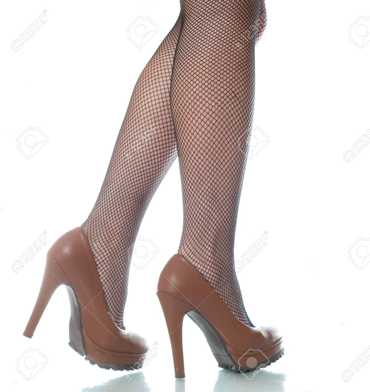 Beautiful Female Legs In Brown Shoes A White Background Legs