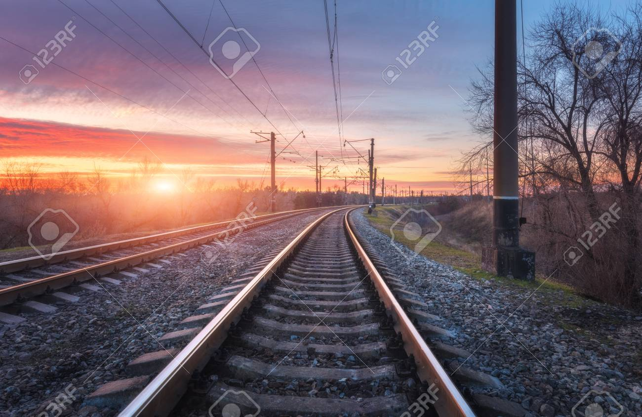 Railroad Against Beautiful Sunny Sky Industrial Landscape With Railway Station Blue And Colorful
