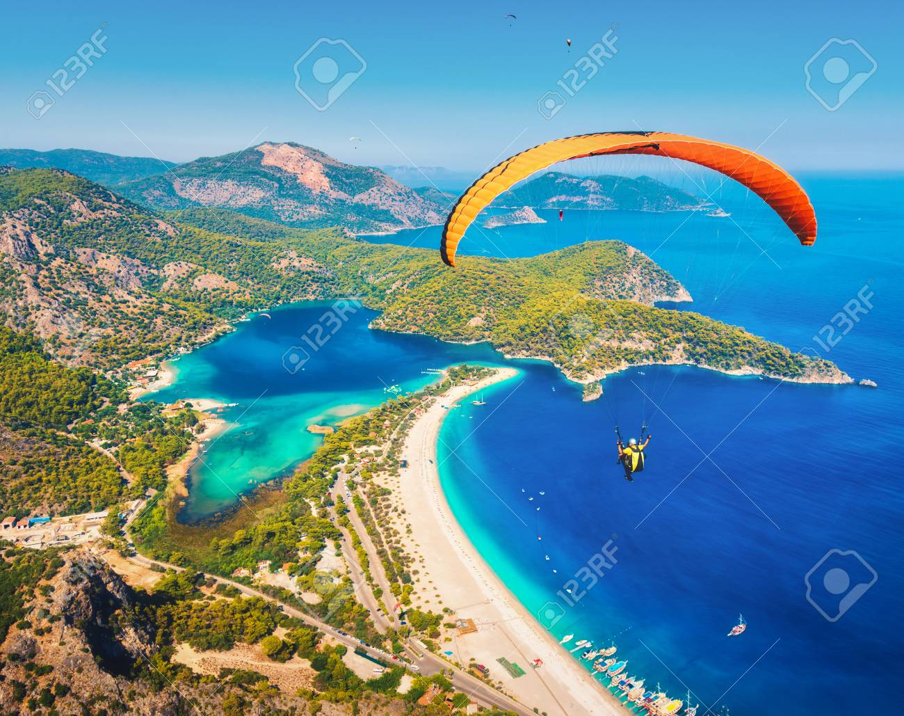 Paragliding in the sky  Paraglider tandem flying over the sea