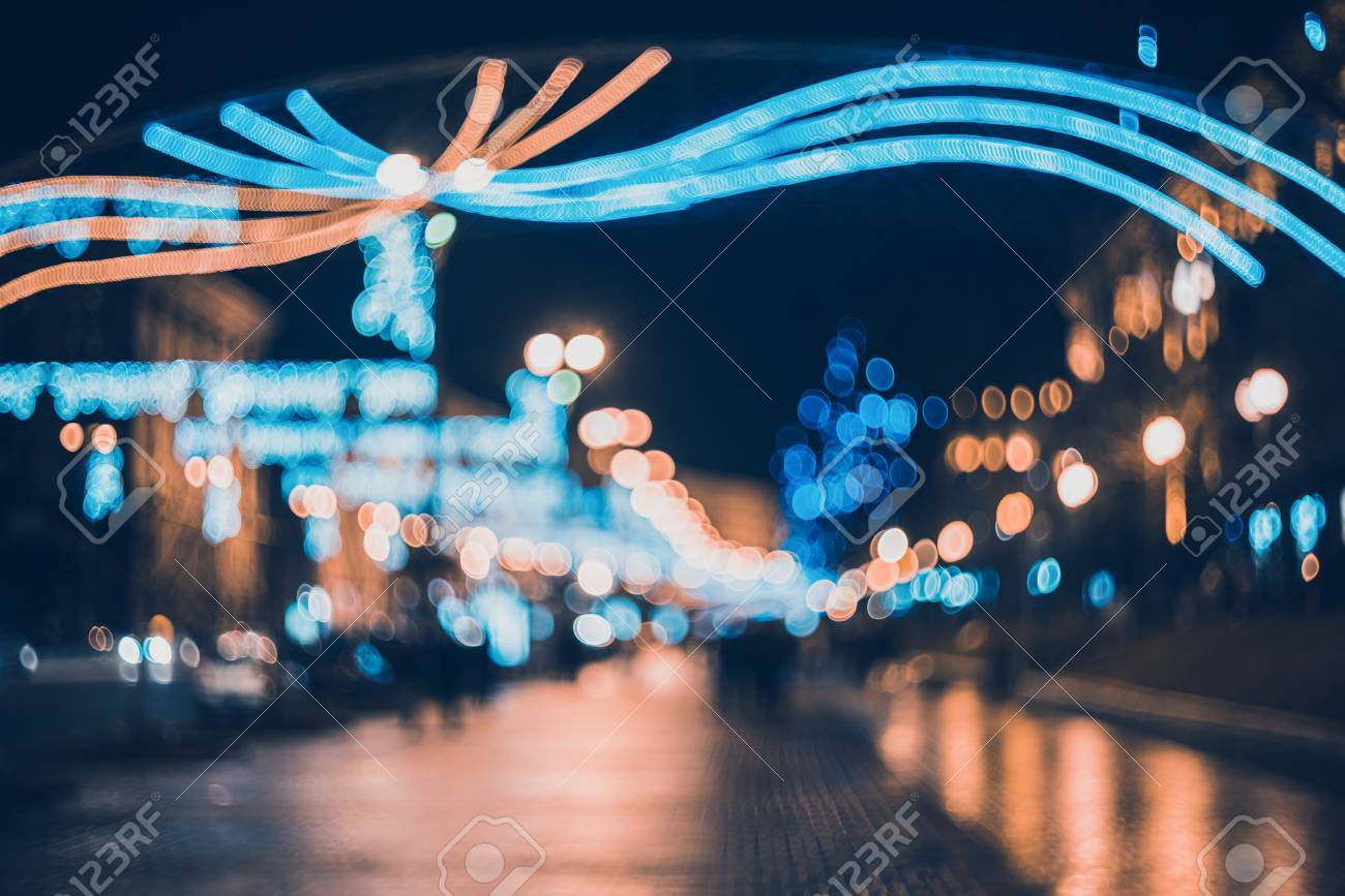 Turquoise Christmas Lights.Blurred City With Christmas Lights At Night New Year Bokeh Background