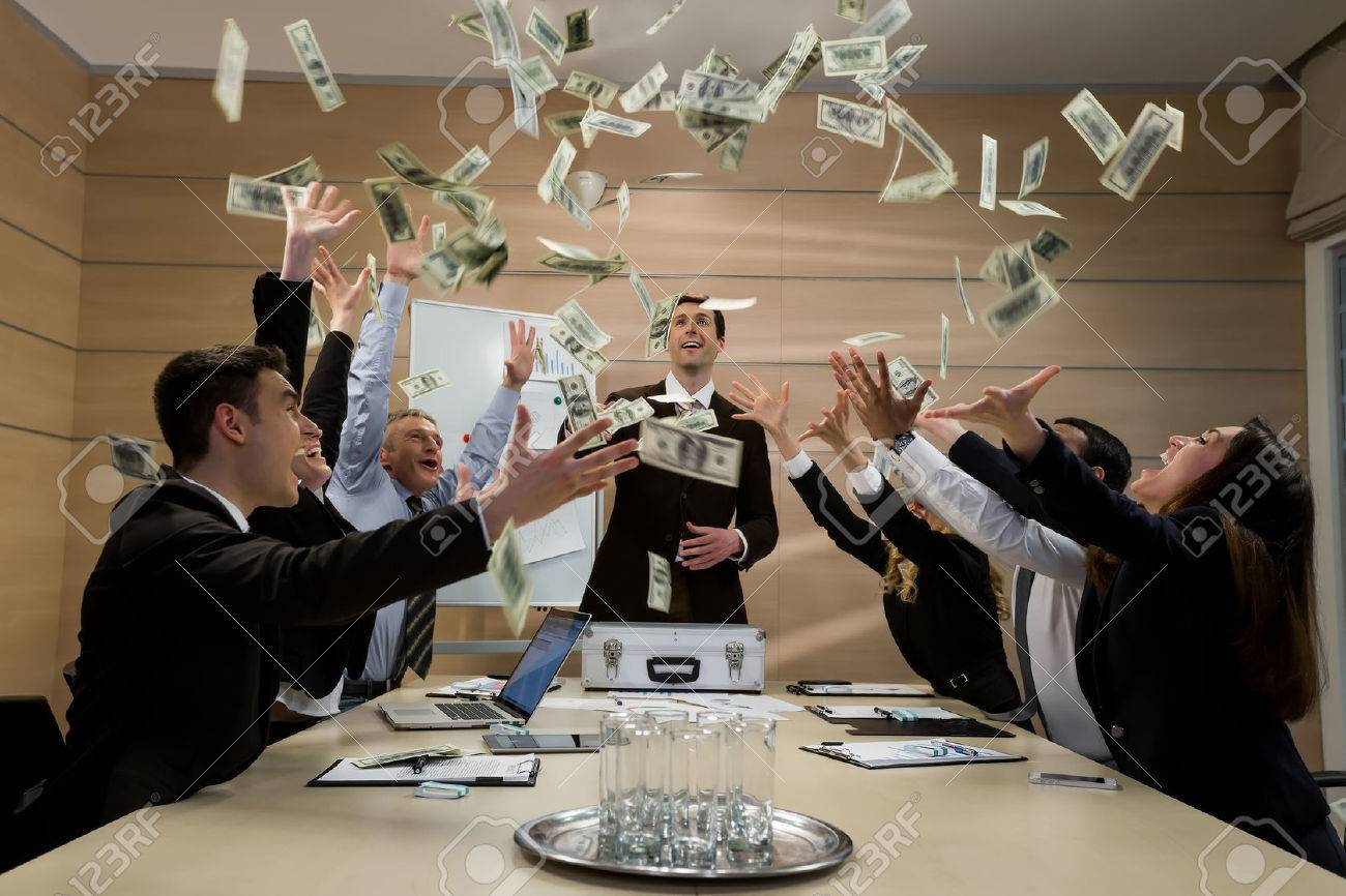 Businessmen scatter the dollars. Managers celebrate success. Successful business. - 50350343