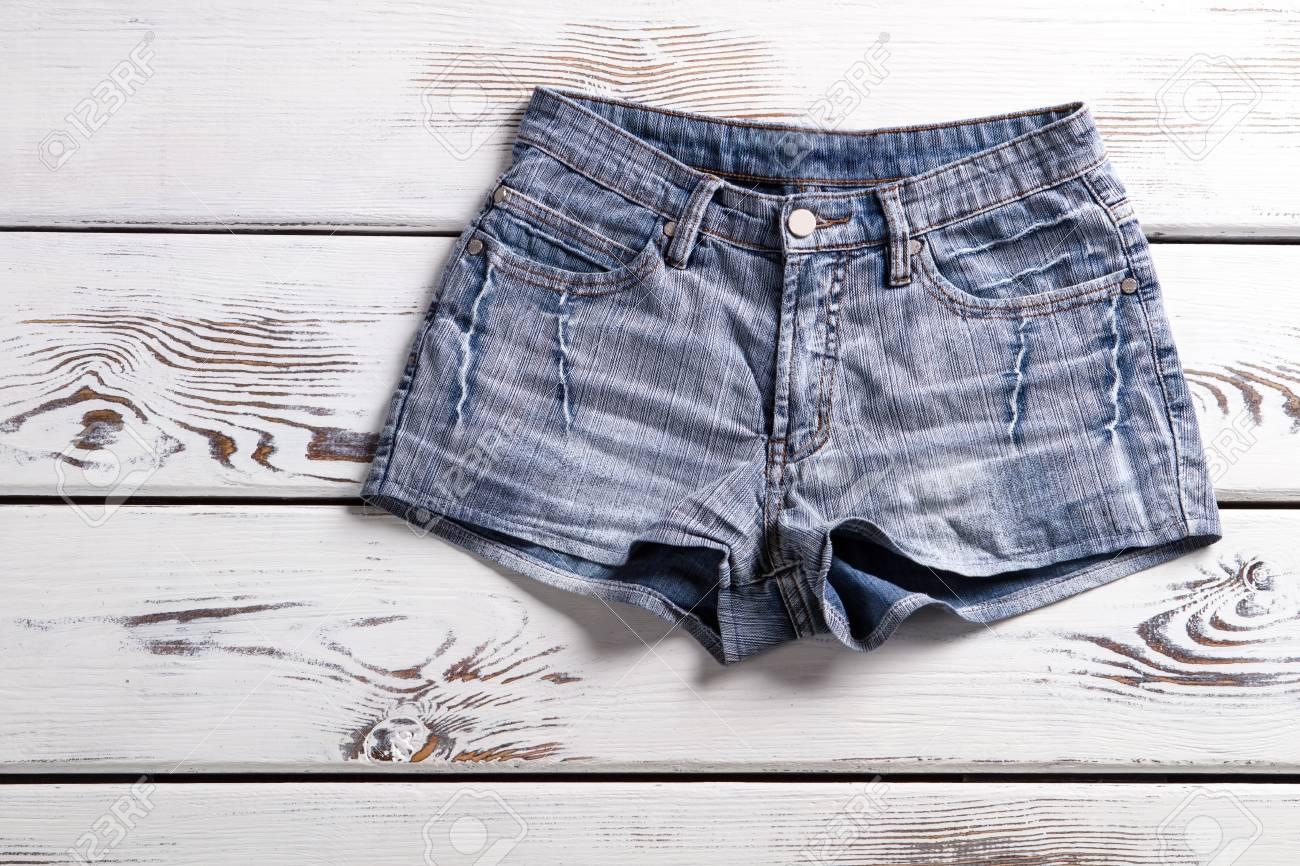 0f674664b7 Female vintage denim shorts. Shorts on white wooden background...