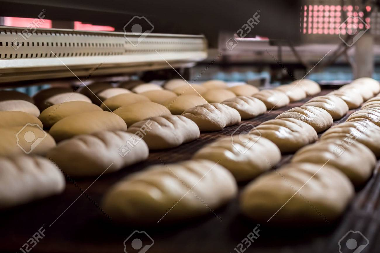 Dessert bread baking in oven. Production oven at the bakery. Baking bread. Manufacture of bread. - 55415011