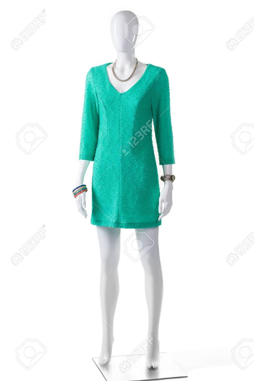 69c732bf78 Foto de archivo - Vestido turquesa ocasional en maniquí. maniquí de mujer  en vestido de color turquesa. ropa casual de colores brillantes de la  señora. ropa ...