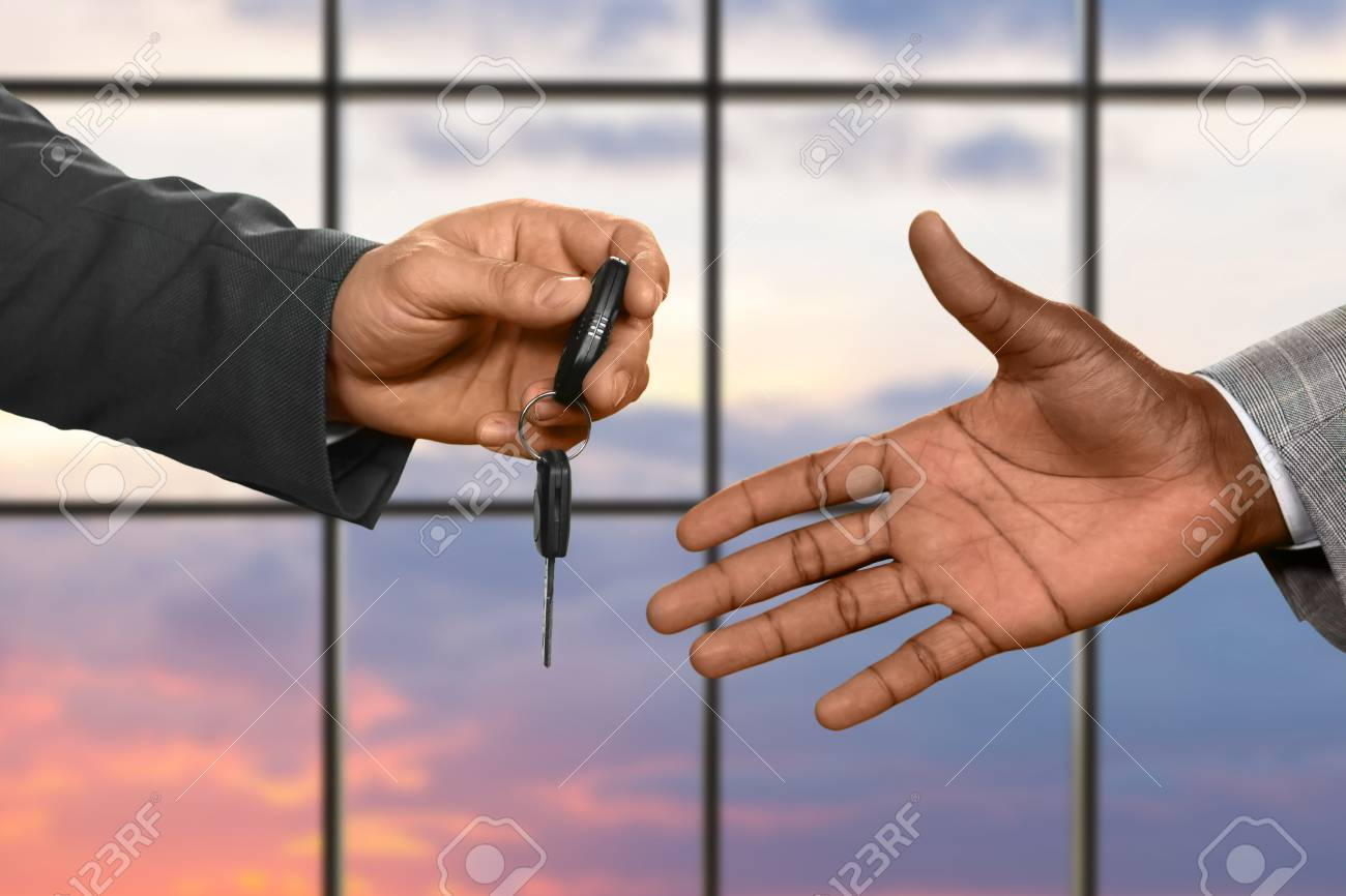 Man S Hand Passing Car Key Car Key On Sunrise Background Always