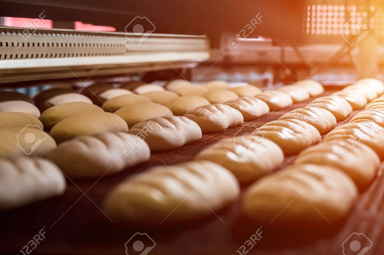 Dessert bread baking in oven. Production oven at the bakery. Baking bread. Manufacture of bread. - 57173550