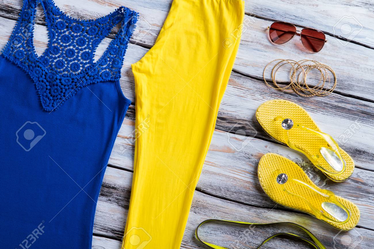 83e3c49bdcdcb Blue tank top and sunglasses. Casual pants with flip flops. Brand new  apparel on