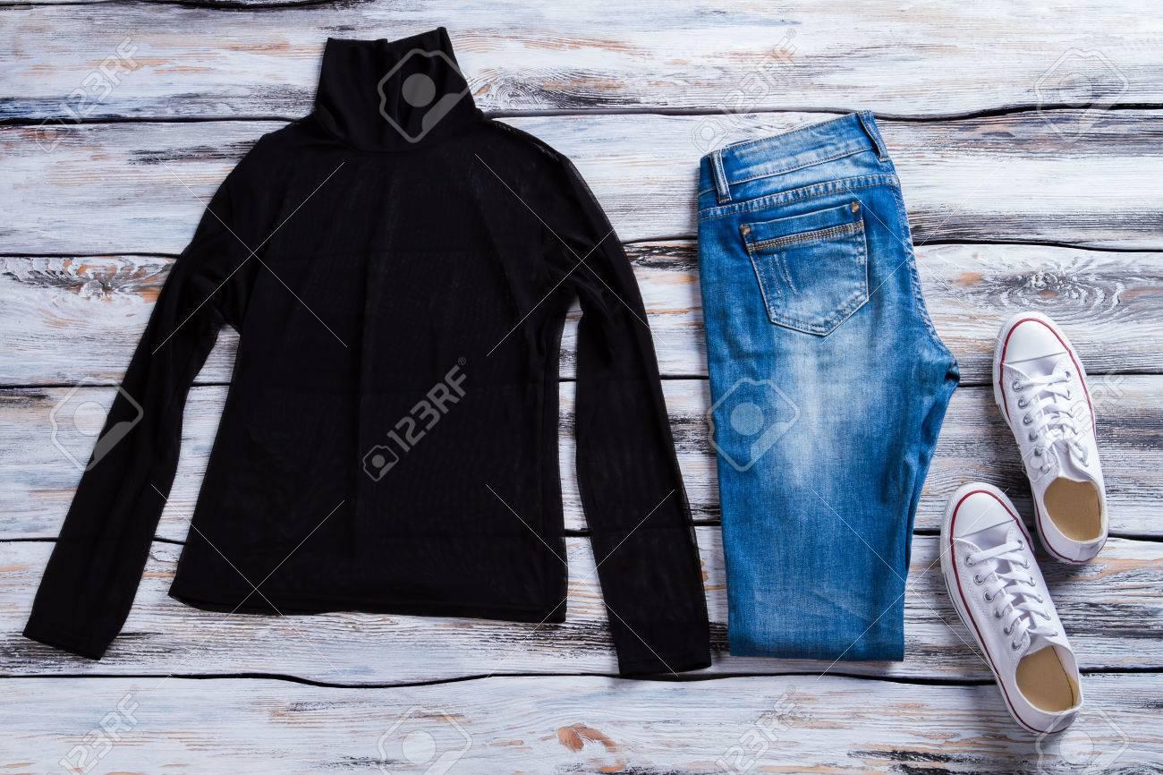 Blue Jeans. White Canvas Shoes