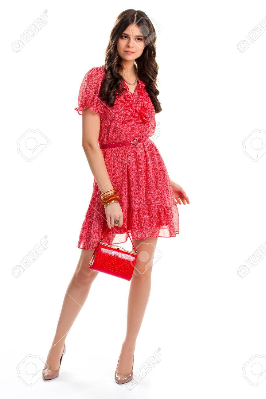 f869fde3fdf Lady in red dress. Woman's purse and bracelets. Casual dress from new  collection.