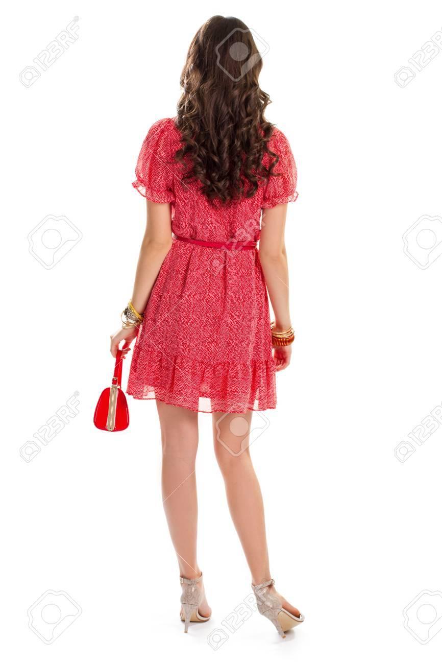 dame tragen kurze Ärmel kleid. rotes kleid und dünnen gürtel. stilvolle  geldbeutel und hand zubehör. rückansicht des weiblichen modells.