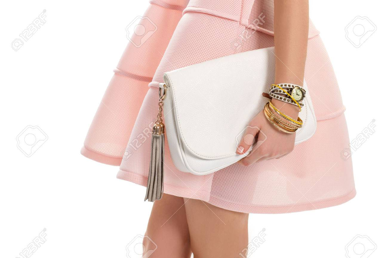 07f3ec2035d4 Girl s hand holds white bag. Small classic watch and bracelets. New leather  handbag.