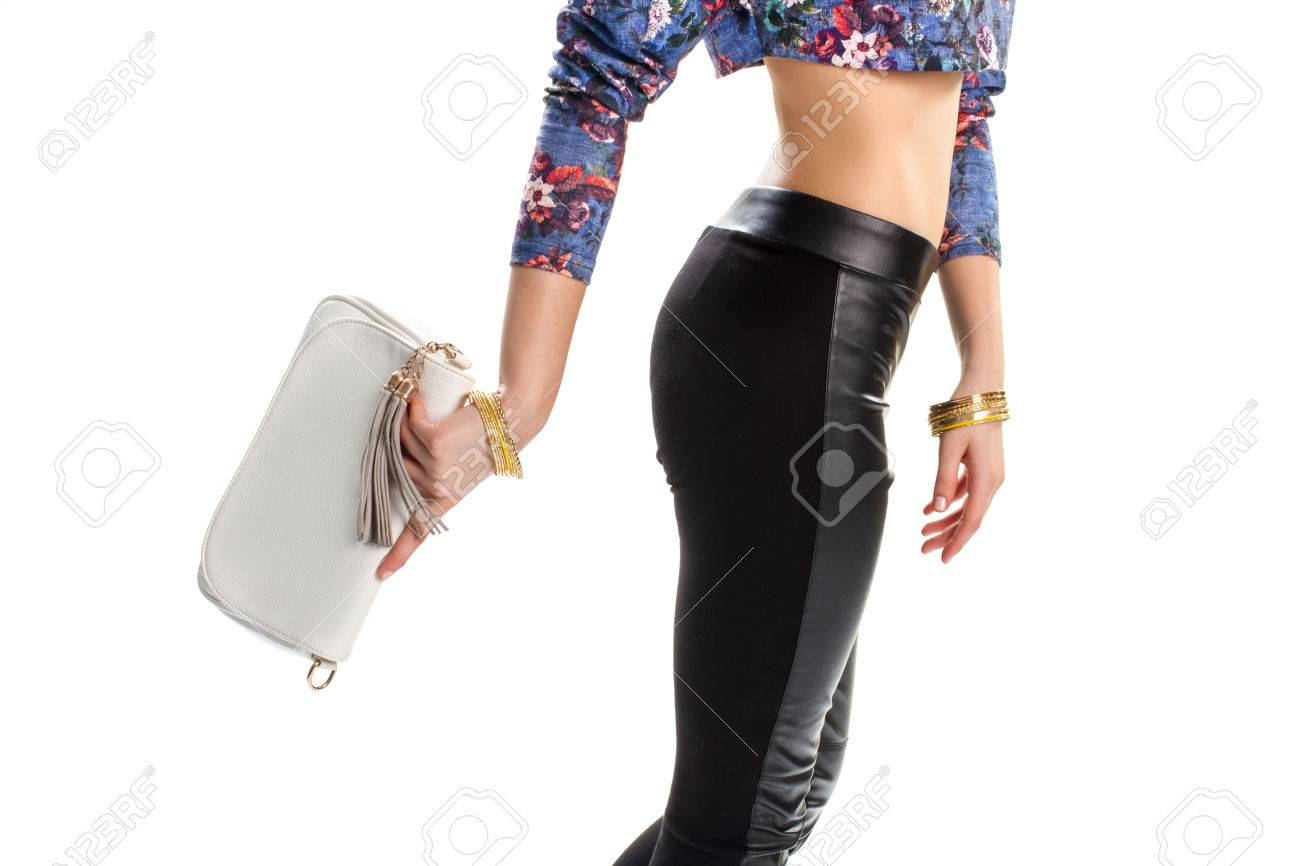 Female Hand Holding White Purse Colorful Bracelets And Black