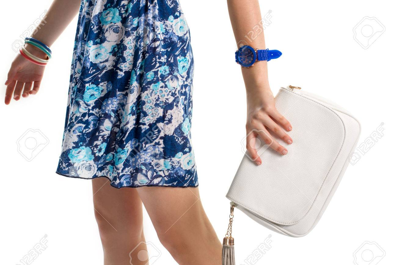 Woman\'s Hand With Blue Watch. Floral Dress And White Purse. New ...
