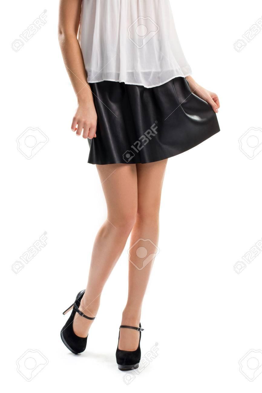 Girl In Short Black Skirt. Dark Heels