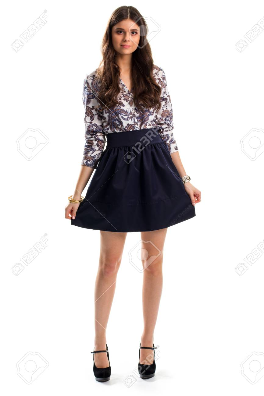 Lady in floral shirt. Navy skirt and black heels. Cute model..