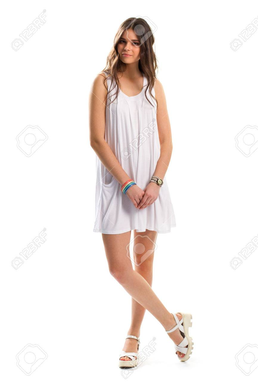 d84441d92de6 Stock Photo - Woman in short sundress. Sandals and wrist accessories.  Attractive look of young model. Plain white outfit.