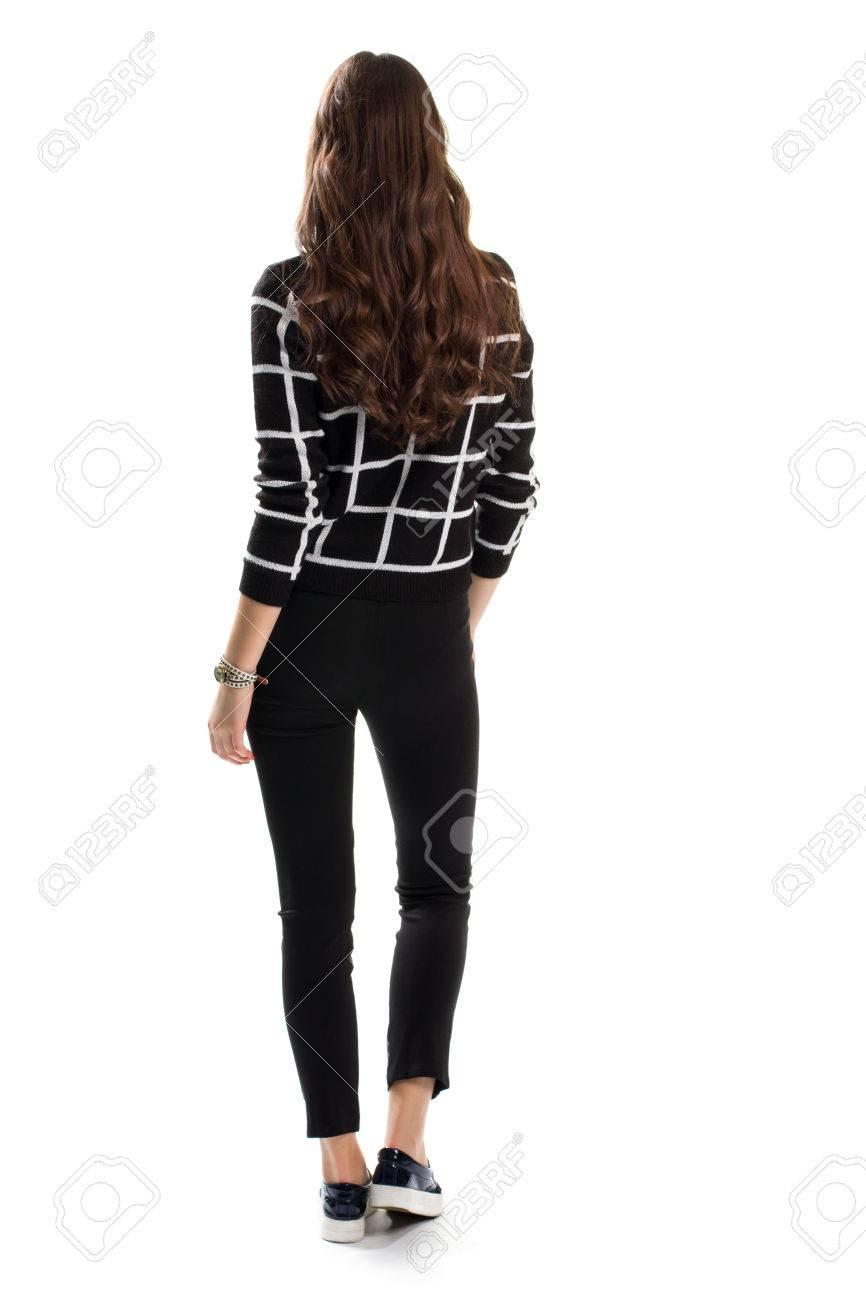 plus récent e6d2a ba7bf Femme en pull à damier noir. Vue arrière du pantalon skinny. Look d'été à  la mode. Vêtements décontractés du nouveau catalogue.