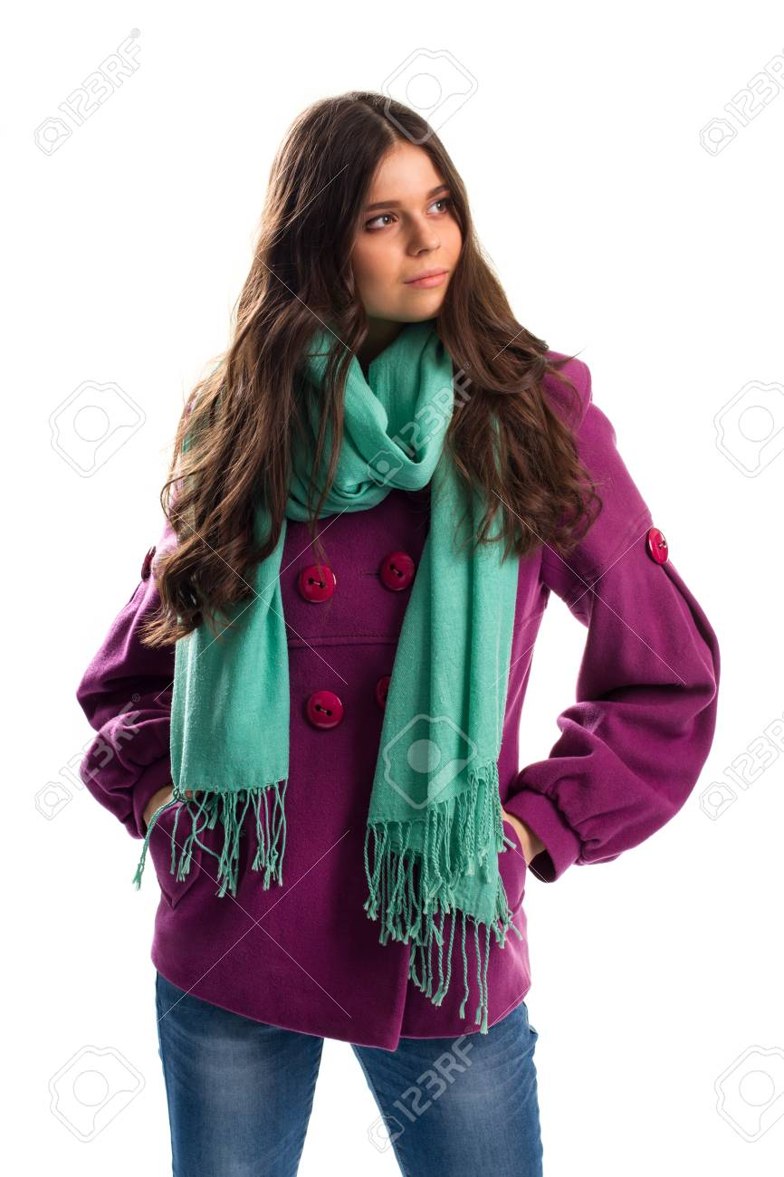 Girl in purple coat. Scarf with fringe and jeans. New fleece outerwear. Warm autumn outfit with scarf. - 59818729