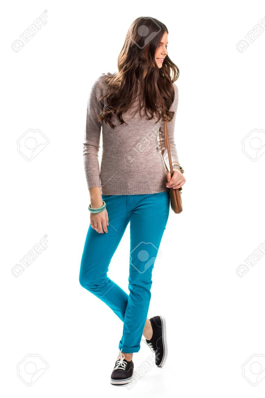 0993a33fd6 Stock Photo - Woman in plain beige sweater. Bright turquoise pants. Trendy  slim-fit trousers. Nice outfit with accessories.