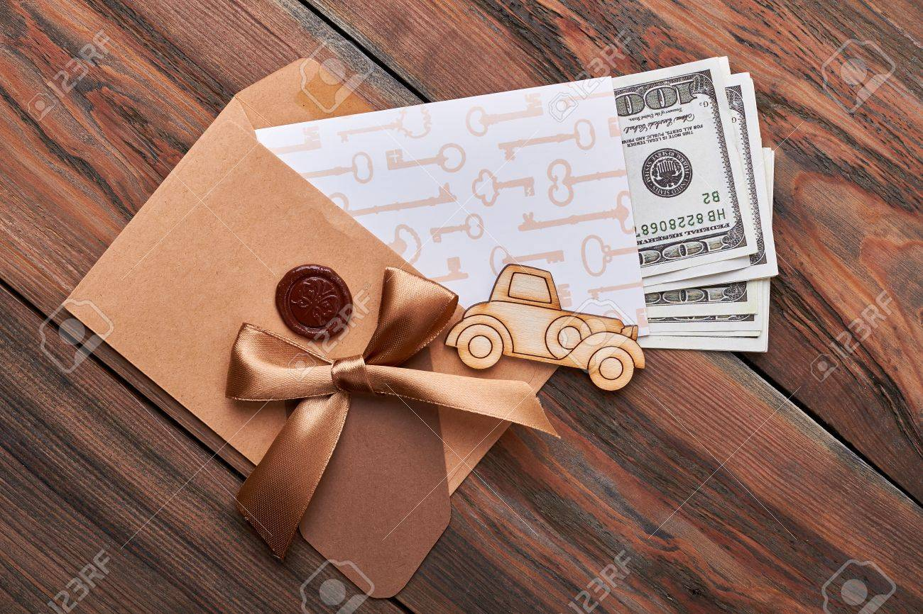 dollar bills in sealed envelope car bow key print paper broad