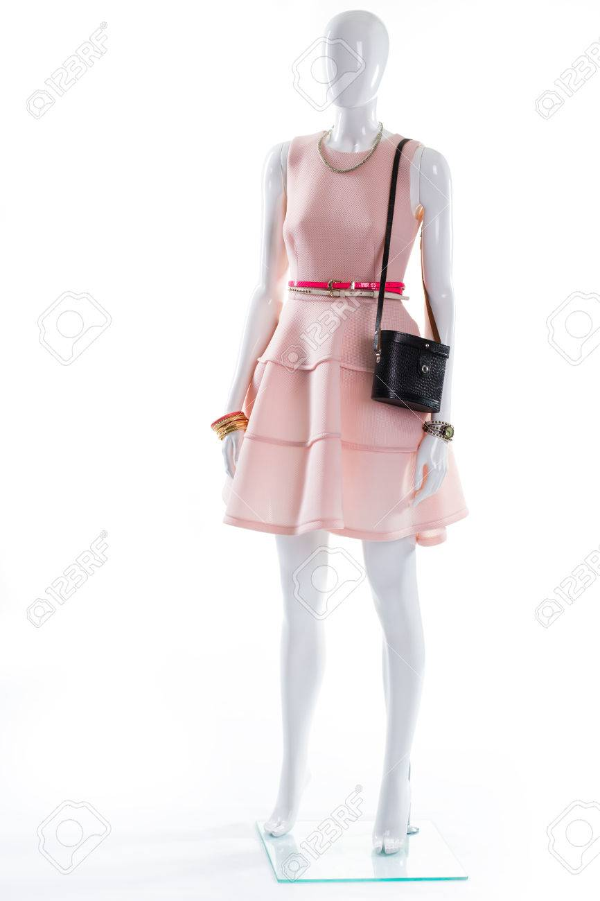 65225aa8cf30c Womans stylish apparel with accessories. Dress and bijouterie on mannequin. Female  mannequin in expensive outfit. Delicate jewelry and stylish