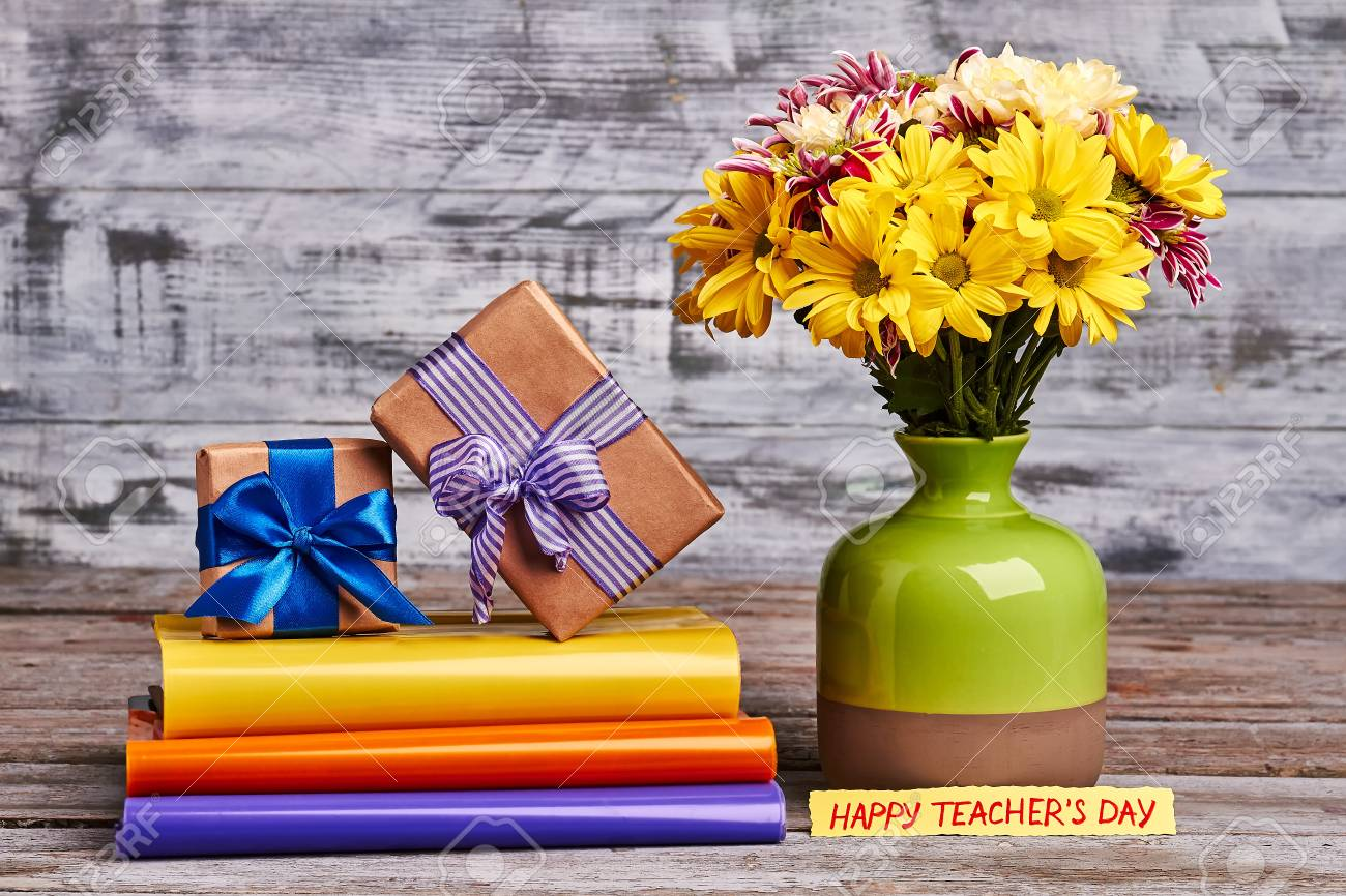 Flowers Vase And Gift Boxes Beautiful Autumn Present For Teacher Stock Photo Picture And Royalty Free Image Image 72333670