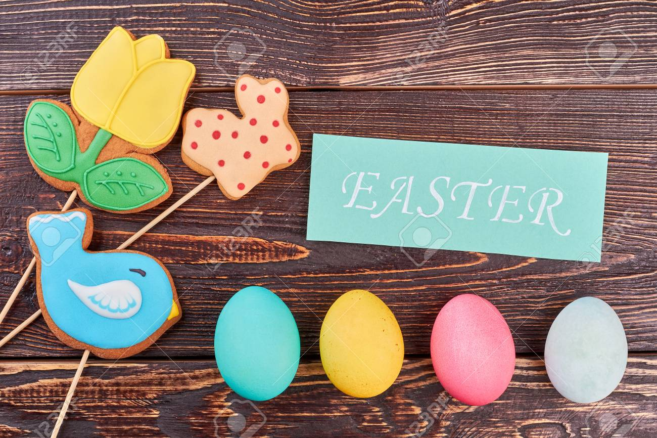 Easter Eggs Cookies And Card Biscuits With Icing On Wood Easter