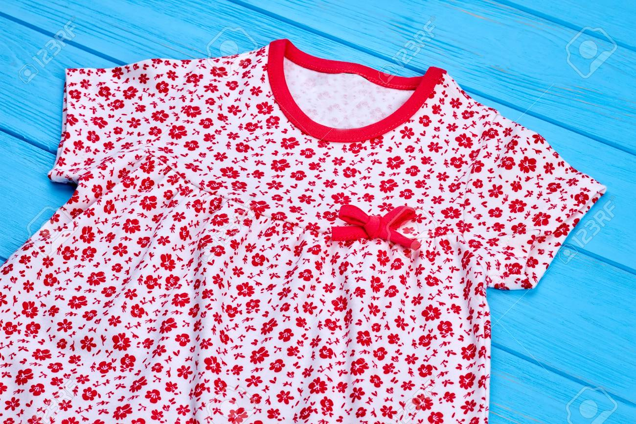 e1cb31b8e Infant girl cotton dress with a bow. Close up of natural summer apparel fo  baby