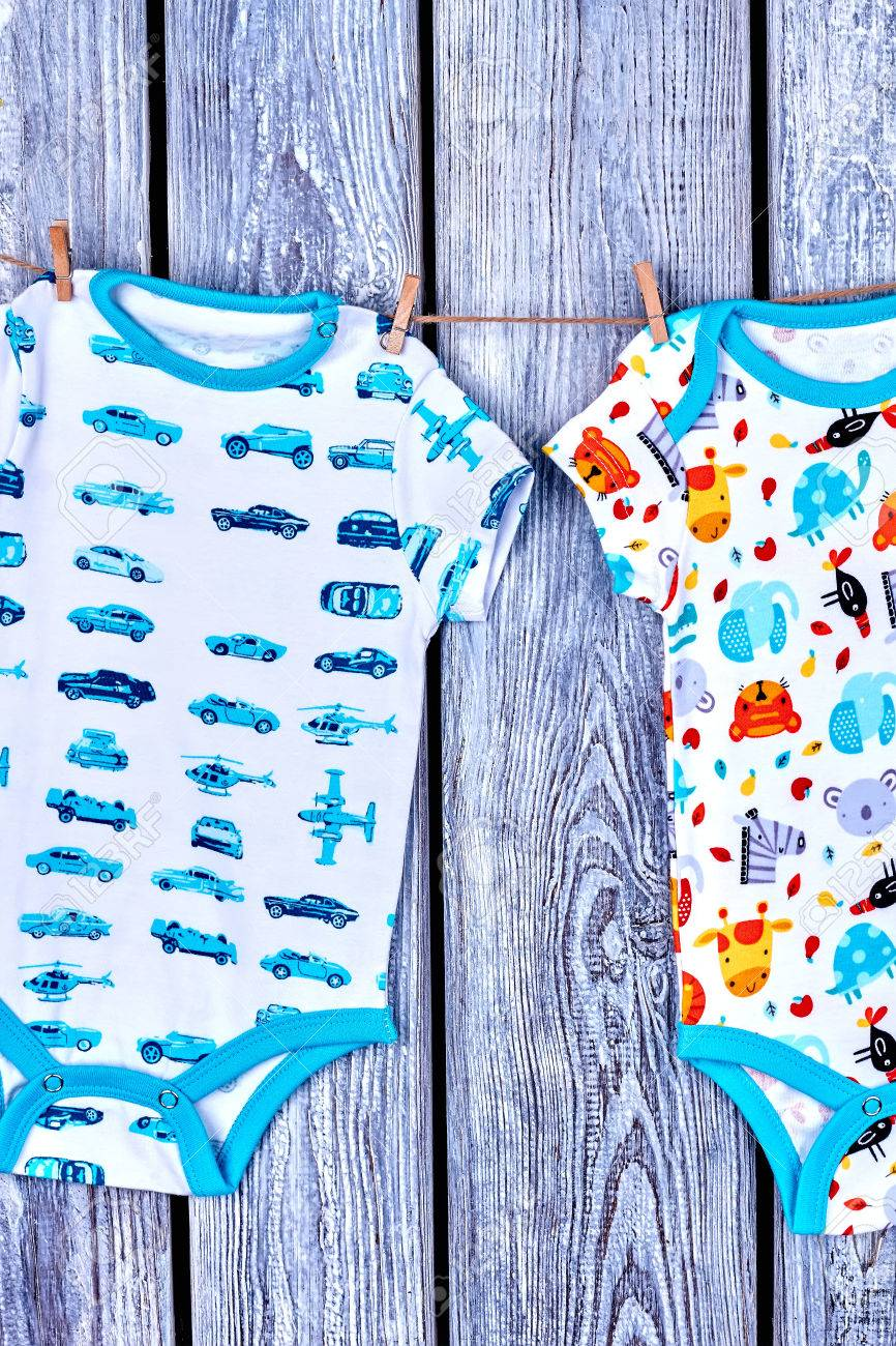 3973a7994216 Baby Boy Rompers Hanging On Clothesline. Infants Summer Wear.. Stock ...