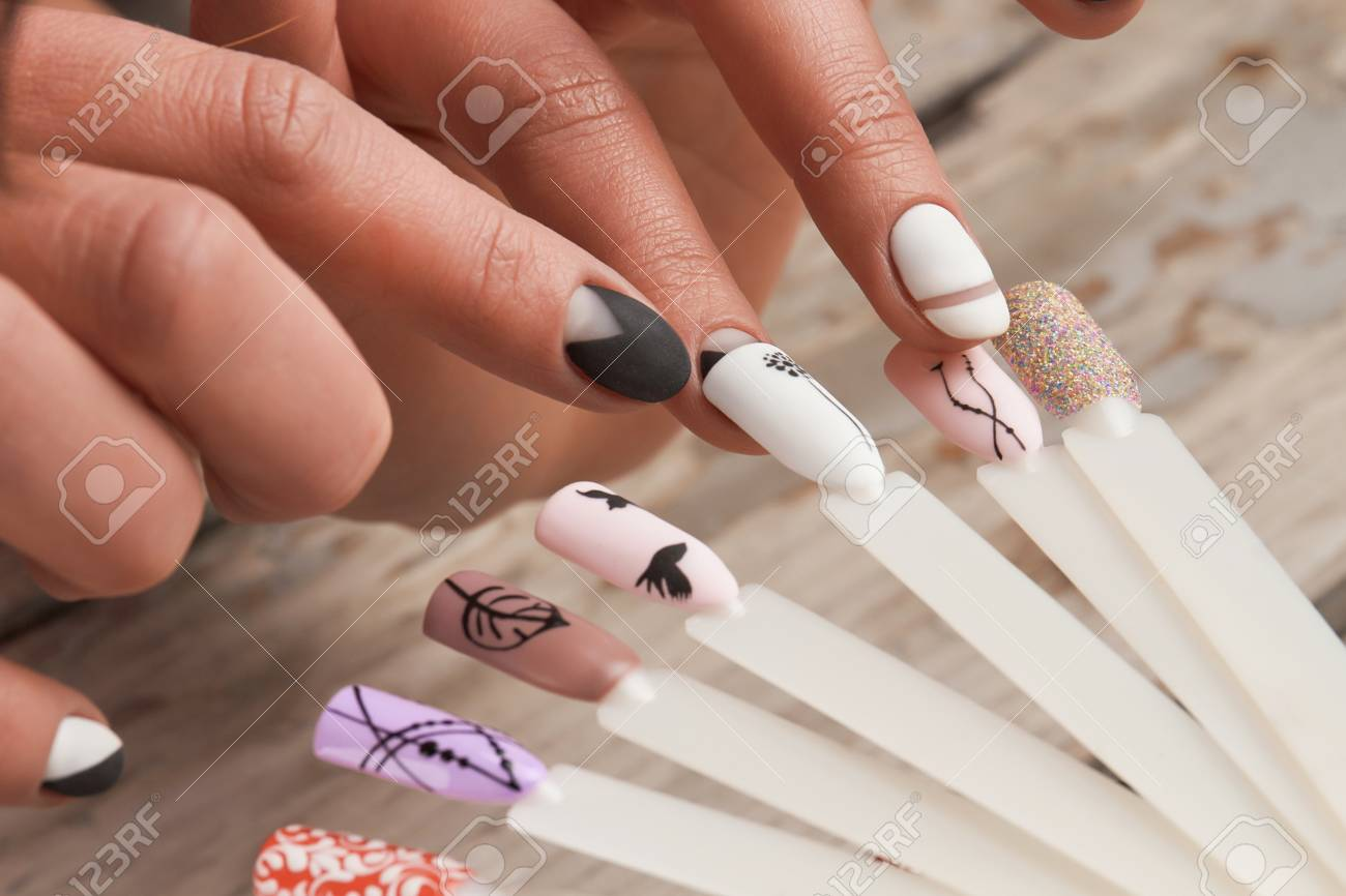 Woman In Nail Salon Choosing Nail Design. Close Up Of Female.. Stock ...