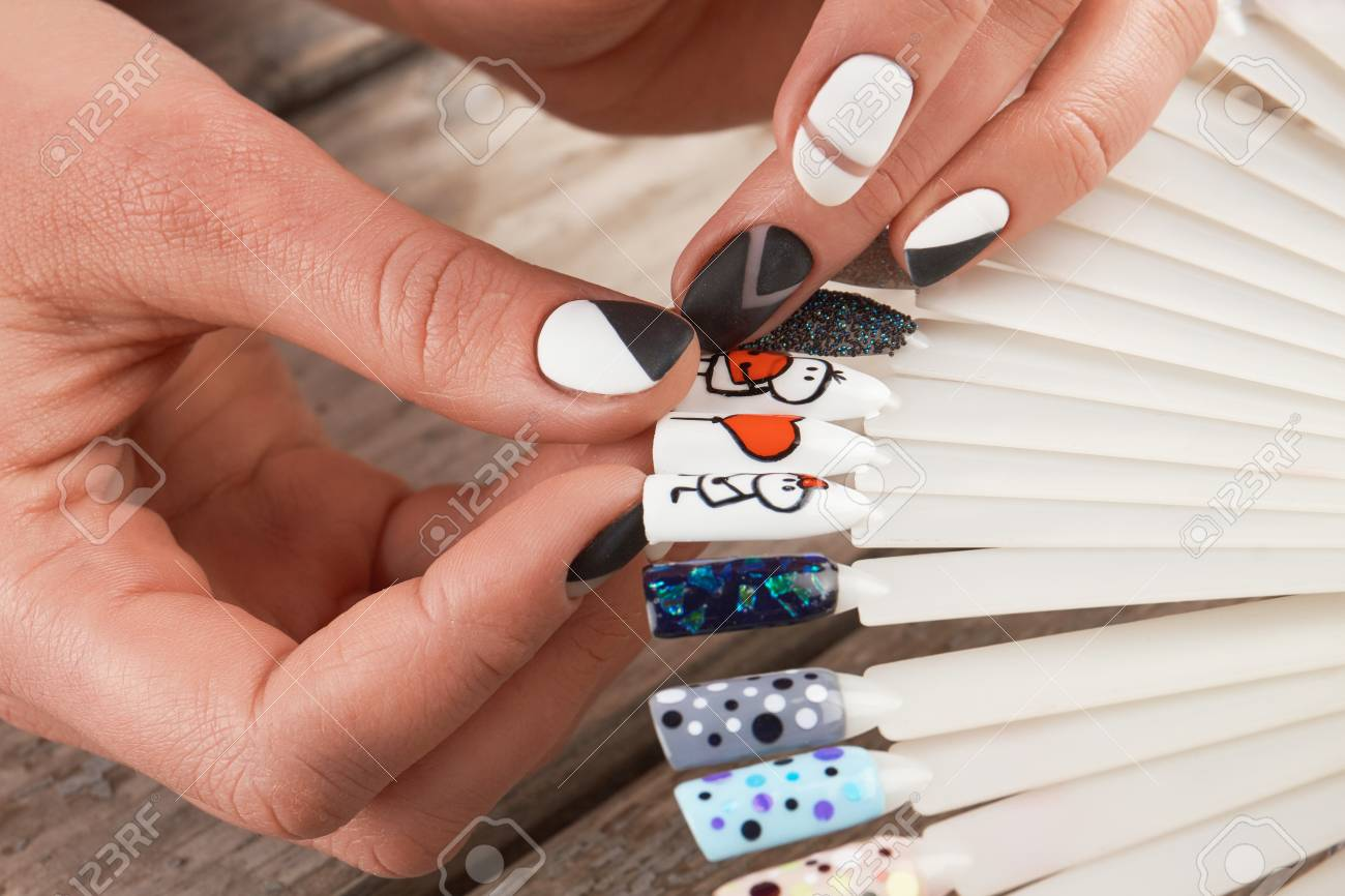 Close Up Of Female Hands And Nail Art Samples. Woman Hands With ...