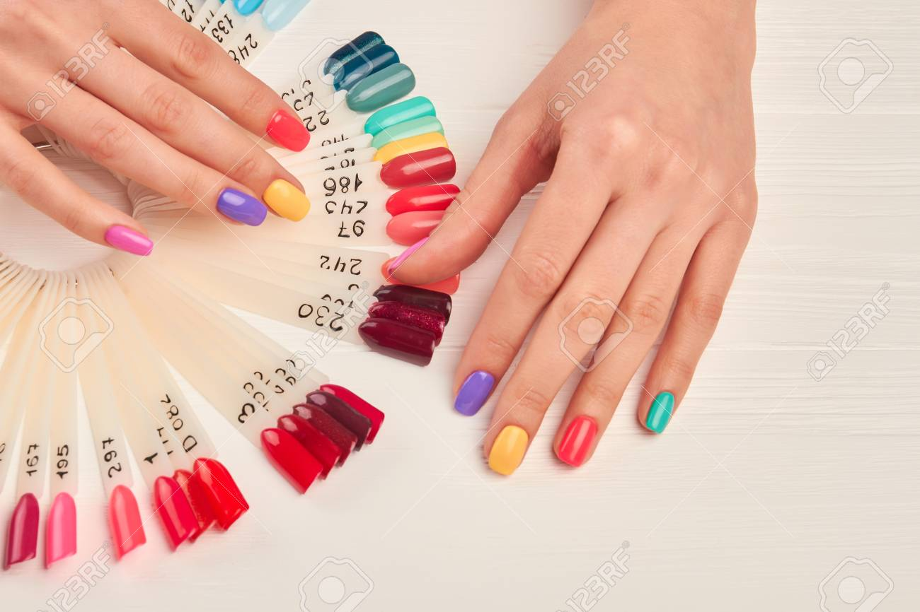 Well-groomed Hands And Nail Color Samples. Female Hands With.. Stock ...