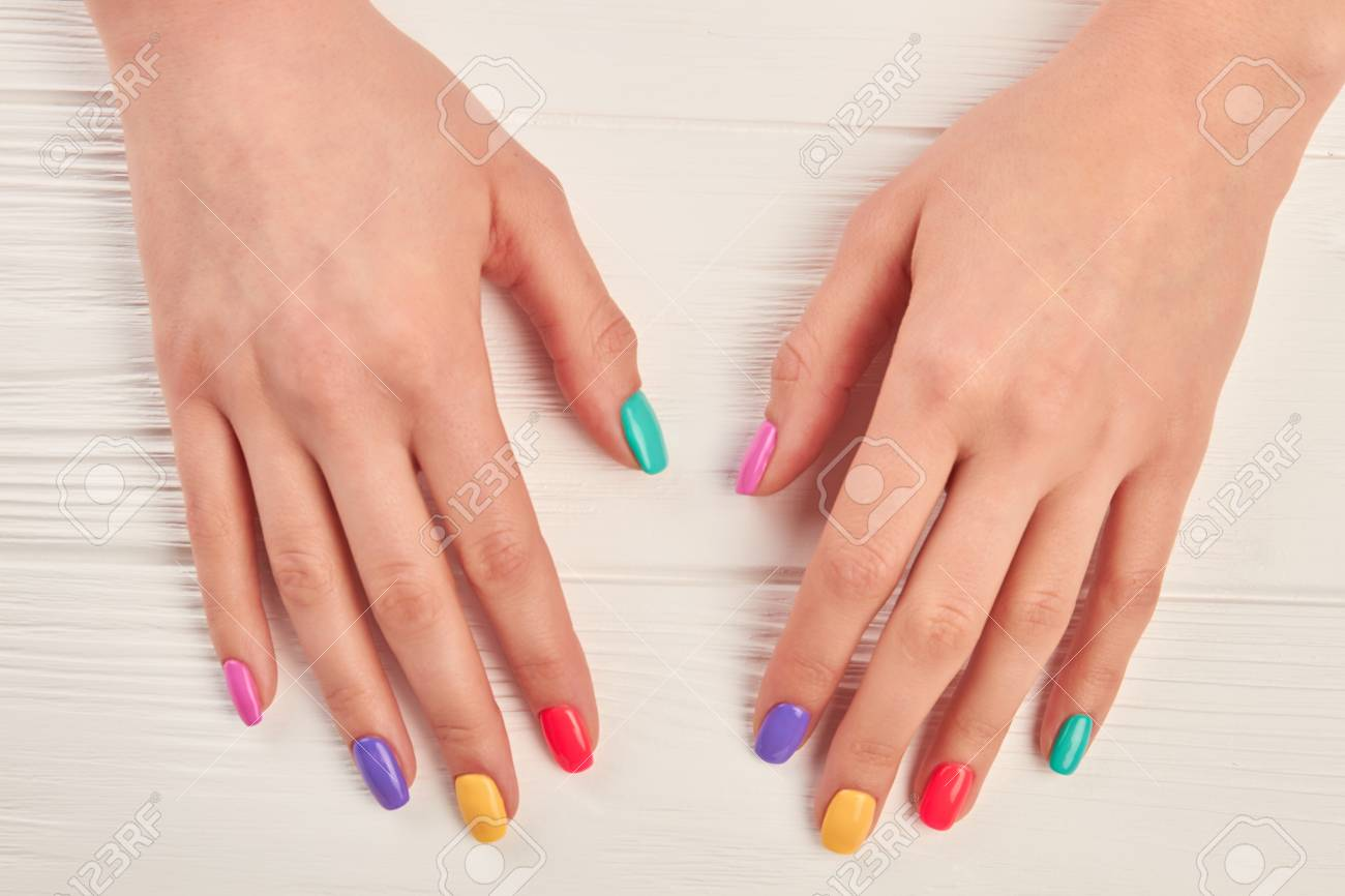 Female Hands With Multicolored Varnish On Nails. Girl Hands With ...