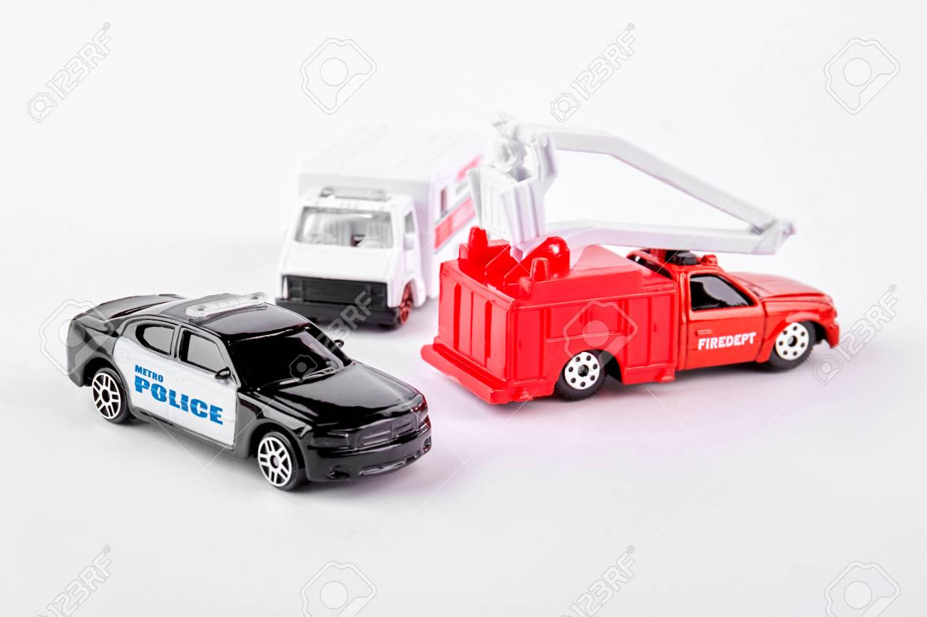 Fire truck, ambulance and police cars toys over white background