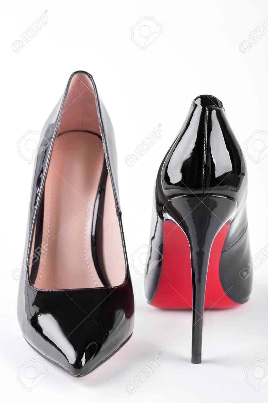 844fc404c6ac Female fashion louboutin shoes. Woman elegant shoes on high heels isolated  on white background.