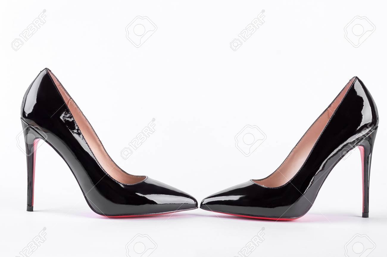 quality design ecafa d63a8 Pair of fashionable louboutin over white. Black leather shoes..