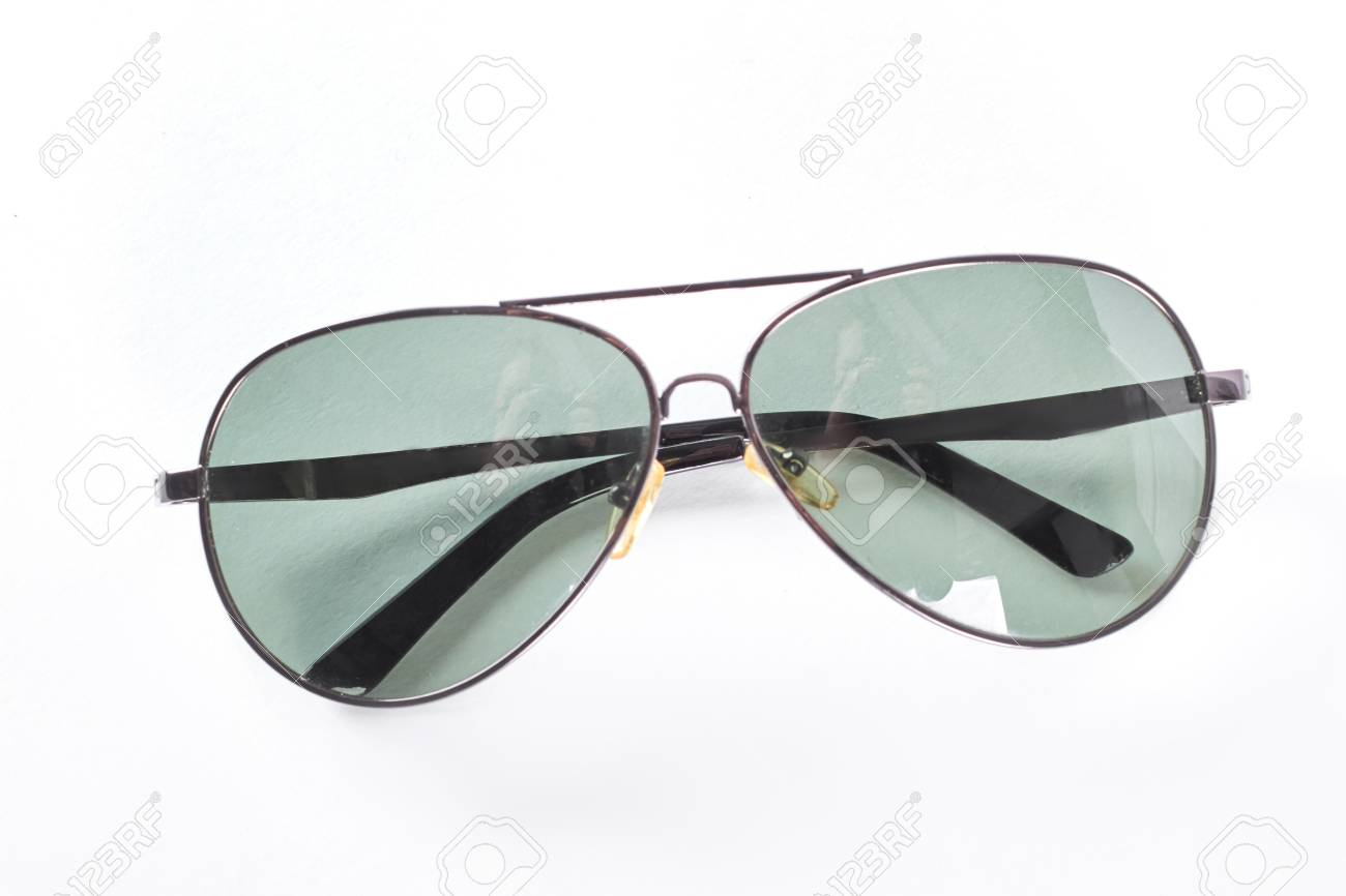 c1d2c2b75b Stock Photo - Sunglasses in a thin metal rim. Eyeglasses with dark glass  isolated on white background.