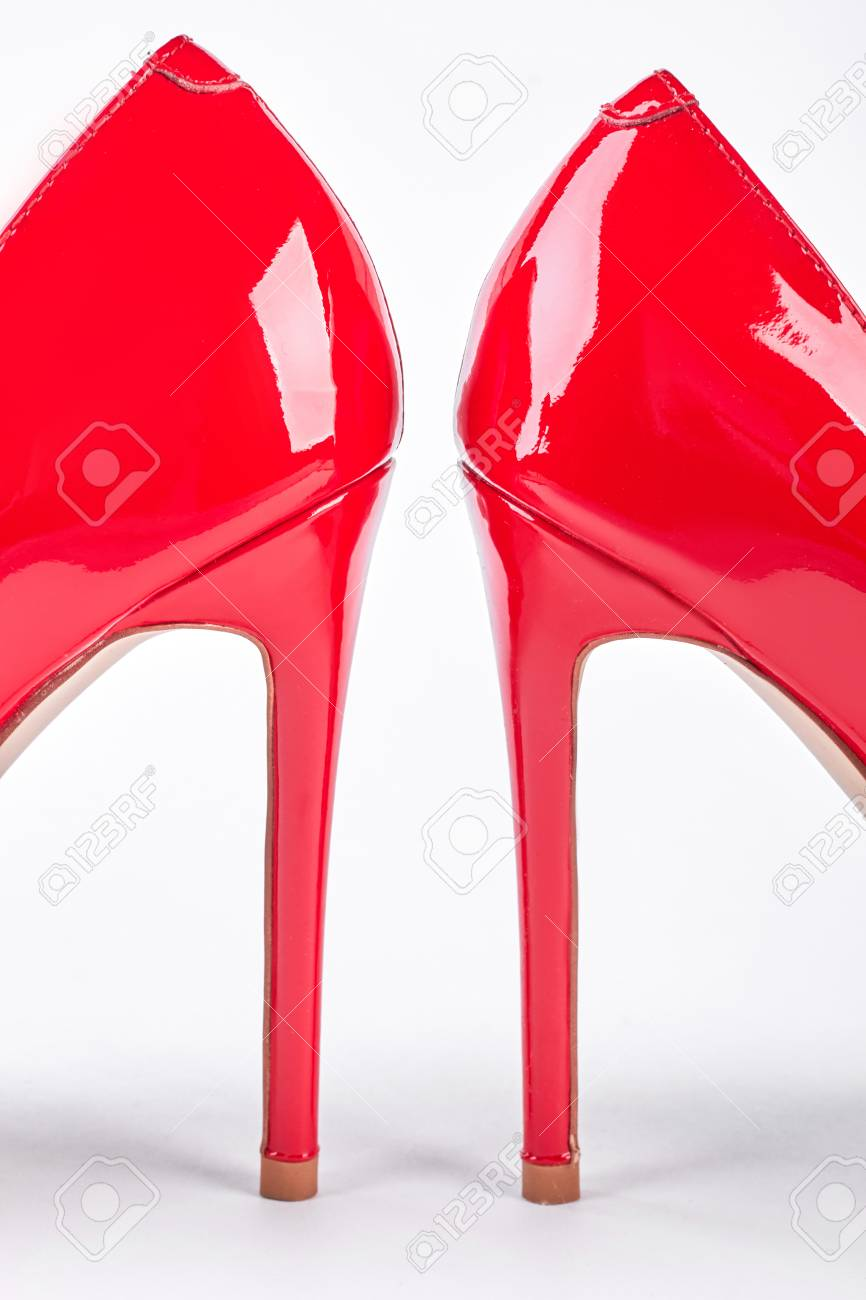 92331a81faf Pair of red lacquered female heels. Woman elegant red shoes o..