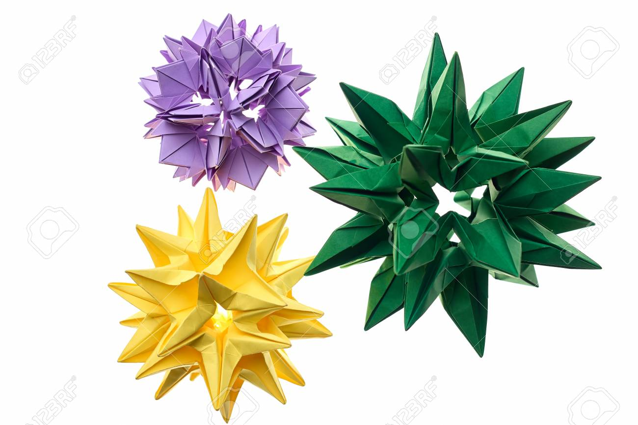 Flower Kusudama Models On White Yellow Green And Violet Origami