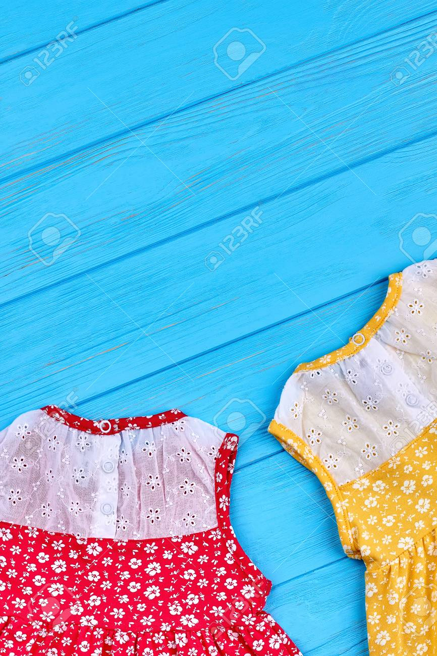 cb0f218c4ce Casual baby dress and copy space. Vintage design little girls summer dresses  on blue wooden