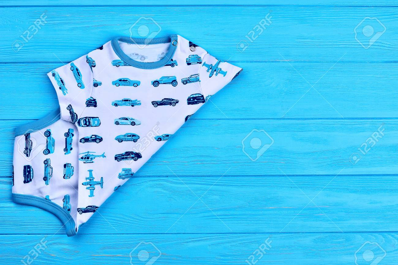 3890ff0747a4 Stock Photo - White and blue baby cotton bodysuit. Baby boy new organic  printed romper and copy space. Newborn summer apparel.