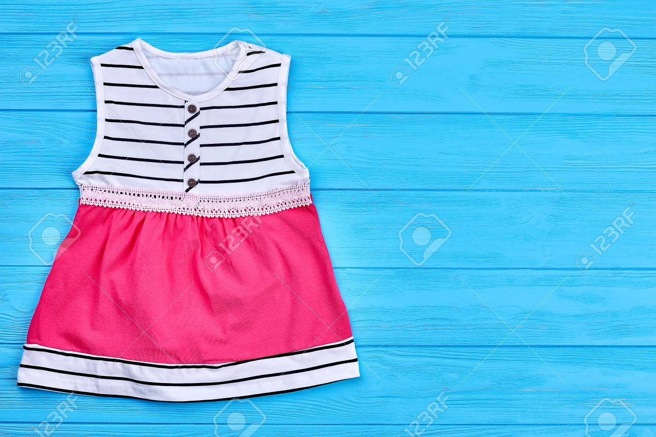 61104940499 Stock Photo - Top quality cotton baby dress. Summer children fashion  sundress and copyspace. Little girl modern dress with embroidered belt.